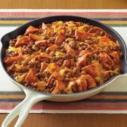 Beef Taco Skillet Recipe - Favorite flavors of the Southwest, featuring salsa, tortillas and melted cheese, will make this easy skillet supper a family favorite.