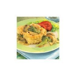 Chicken Dijon in Pastry Shells Recipe - Elegant, easy and exquisite, individual puff pastry shells are filled with a mixture of chicken, broccoli and mushrooms in a creamy Dijon sauce.  Try these at your next dinner party.