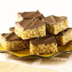 Chocolate Scotcheroos Recipe - Chewy, crispy peanut butter bars are spread with chocolate and butterscotch for a new family favorite treat.