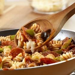 Pasta with the Works Recipe - Pepperoni, olives, green peppers, Prego(R) Traditional Italian Sauce, and mozzarella cheese are heated together to top corkscrew pasta sprinkled with Parmesan cheese.