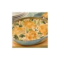 Chicken and Rice Dinner Recipe - Rice and broccoli are simmered with Campbell's(R) Condensed Cream of Mushroom Soup and topped with chicken breasts for this crowd-pleasing one dish meal.