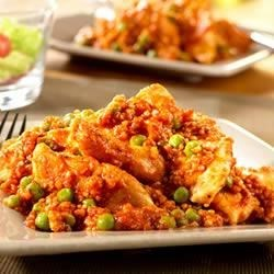 Chicken with Peas and Quinoa Recipe - Ever tried Quinoa? It makes a nice substitute for rice or couscous, and this recipe is a delicious introduction to its fabulous taste and texture.