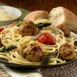 Linguini with Roasted Vegetables and al fresco Italian Style Chicken Meatballs Recipe - Roasted tomatoes, asparagus, onion and tasty browned chicken meatballs are tossed with linguini, fresh basil and grated Parmesan cheese in this quick, colorful and delicious one-dish meal.
