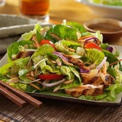 Asian Island Grilled Chicken Salad Recipe - Pineapple-marinated chicken breast and red bell pepper strips top this crunchy Asian salad.