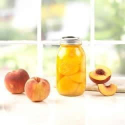 Honey-Spiced Peaches Recipe - Serve up a taste of summer any time of year when you preserve fresh, ripe peaches with honey and spices.