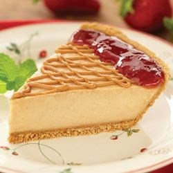 Peanut Butter and Jelly Pie from JIF(R) Recipe - A creamy peanut butter filling decorated with strawberry preserves and a drizzle of peanut butter make this pudding pie a standout.