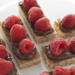 Raspberry Hazelnut Truffle Toast Bites Recipe - Need something sweet? These small bites from Roman Meal will satisfy your need to indulge.