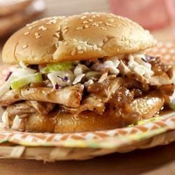 Down-Home Easy Barbecue Pork Rolls Recipe - Sliced roast pork simmers with in a hot and zesty barbecue sauce and is served North Carolina-style piled on sandwich rolls and topped with coleslaw.