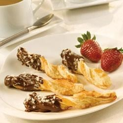 Chocolate-Dipped Spiced Twists Recipe - Pepperidge Farm(R) Puff Pastry Sheets are sprinkled with a mixture of ground crystallized ginger root and sugar, cut and shaped into twists, baked until golden, and then partially dipped in melted chocolate.