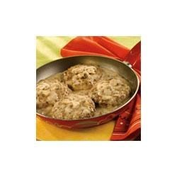 Simple Salisbury Steaks Recipe - Using ground beef to make salisbury steak patties ensures a tender salisbury steak with a shortened cooking time. Mushrooms and cream of mushroom soup cook with the patties to make a savory and creamy gravy.