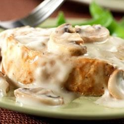 Pork with Mushroom Dijon Sauce Recipe - White wine and mustard season a creamy sauce featuring Campbell's(R) Condensed Cream of Mushroom Soup for topping tender, golden pork chops.