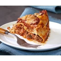 Slow-Cooker Lasagne Recipe - Come home to the delicious aroma and flavors of lasagne, cooked in your slow cooker with ground beef and 3 kinds of cheese.