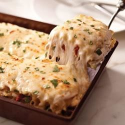 Creamy White Chicken and Artichoke Lasagna Recipe - Nothing brings the family together like a warm dish straight out of the oven. Try this timely twist on a classic.