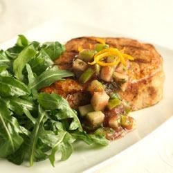 Wilted Arugula Pork Salad Recipe - Orange zest, cilantro, and a little bit of jalapeno pepper flavor the cranberry-apple salsa topping these pork chops.
