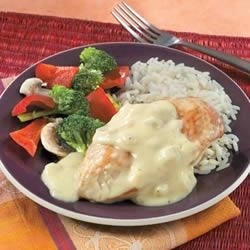 Campbell's(R) Creamy Dijon Chicken with Rice Recipe - Browned chicken simmers in a creamy mustard sauce, then served with hot rice.