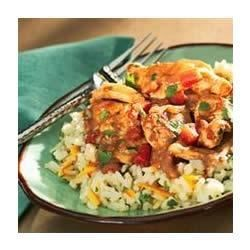 Quick Chicken Peanut Mole with Cilantro Rice Recipe - Boneless strips of chicken breasts and thighs are cooked up in a skillet with a creamy peanut butter, cocoa and cinnamon scented sauce and served over cilantro rice.