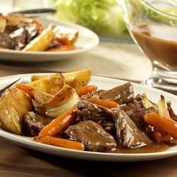 Weekday Pot Roast and Vegetables Recipe - Use Campbell's(R) Beef Gravy to make a satisfying and delicious pot roast in the slow cooker for your hungry family.