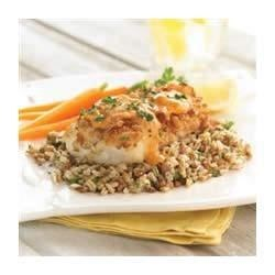 Pretzel Crusted Cod with Apricot Dijon Sauce Recipe - Cod fillets are coated with seasoned crushed pretzels, cooked until golden brown and served with an apricot-dijon mustard sauce in this quick and tasty preparation.