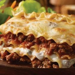 Beef and Mushroom Lasagna Recipe - You can feed up to six people with this hearty lasagna recipe featuring creamy mushroom sauce and Italian tomato sauce layered between sheets of pasta with cheese and beef.