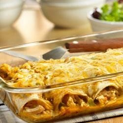 Chicken Enchiladas Recipe - Chopped chicken, green chiles and a flavorful sauce made from sour cream, onion, chili powder and Campbell's(R) Condensed Cream of Chicken Soup are wrapped in tender tortillas and baked with more sauce and shredded Cheddar cheese for a delicious Southwestern-style dish.