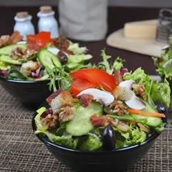 Hearty Vegetable Salad Recipe - Crisp cucumber, enoki mushrooms, and tomatoes are topped with a rich bacon, onion, and mustard salad dressing in this hearty salad.