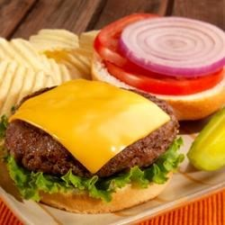 Backyard Burgers Recipe - Big, juicy sausage and beef burgers with Parmesan cheese are the greatest! Serve with your favorite toppings.