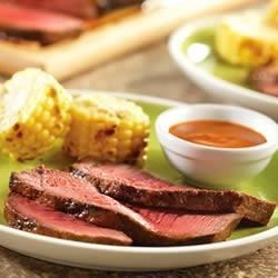 Tangy Grilled Beef Recipe - Worcestershire, lemon, brown sugar, garlic and tomato combine for a steak sauce with lots of punch, perfect for a grilled sirloin steak.