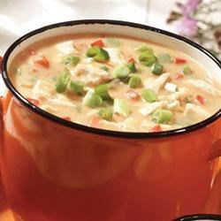 Campbell's Kitchen Cheesy Chicken Chowder Recipe - Cheddar cheese soup forms the base for this quick-cooking chicken chowder that's kicked up with picante sauce and green onions.