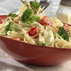 Easy Pasta Primavera Recipe - Fresh vegetables are simmered in oregano-seasoned Swanson(R) Chicken Broth until tender-crisp and tossed with thin spaghetti for a tasty meatless entree.