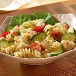 Cool Chicken 'n' Pasta Salad Recipe - This enjoyable salad blends Swanson(R) Chunk Chicken with macaroni, prepared Italian dressing, crisp cucumbers, fresh tomatoes, onion and parsley.