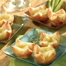 Brie and Walnut Tartlets Recipe - These sweet and creamy puff pastry tartlets are a superb way to begin a dinner party.