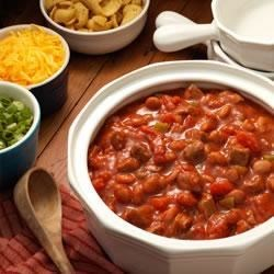 Beefy Cowboy Chili Recipe - Chunks of tender beef and beans in a spicy and hearty tomato-based chili made in less than 30 minutes.
