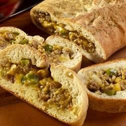 Sausage Bread from Bob Evans(R) Recipe - Crumbled spicy sausage, bell pepper, onion and shredded cheese are rolled into bread dough and baked until nice and brown.