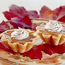 Harvest Pumpkin Tarts Recipe - One of the first recipes to come out of the EAGLE BRAND(R) kitchen, magazine ads in 1927 promised 'glorious pumpkin pie...the kind about which poets have sung.'