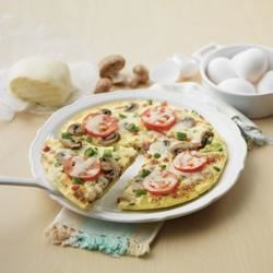 Puffy Pizza Omelette Recipe - Boost any day with this super combo! The flavour of pizza is always a hit and eggs are a terrific, nutritious pick-me-up for any busy week night. The cream creates a puffy, tender omelette – any day magic that's sure to lift the whole family