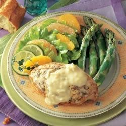 Creamy Chicken and Vegetables Recipe - Sauteed chicken breasts and a medley of vegetables simmer in a creamy mushroom sauce seasoned with lemon, garlic and basil.
