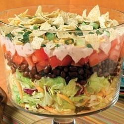 Make-Ahead Mexican Salad Recipe - For a special presentation, serve this Mexican-inspired salad in a clear glass bowl.