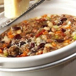Hearty Mixed Bean Stew with Sausage Recipe - Sun-dried tomatoes are the special ingredient that gives this three-bean stew with sausage a sunny Mediterranean flavor.