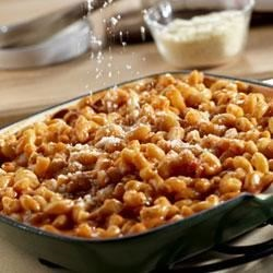 Tomato Mac 'n' Cheese Recipe - Elbow macaroni is dressed with robust Prego(R) pasta sauce and a cheesy sauce for a double-good version of this classic favorite.