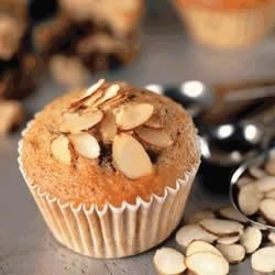 Almond Banana Chocolate Muffins Recipe - These quick banana muffins have chocolate chips and a crunchy topping of California Almonds.