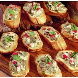 Jimmy Dean Sausage Crostini Recipe - Toasted rounds of sliced French bread are topped with a mixture of sausage, mozzarella cheese, sweet red peppers and fresh basil.