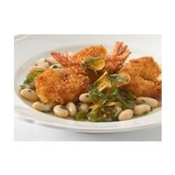 Angry Shrimp with Tuscan White Beans Recipe - When you crave a meal with a kick, this dish is the perfect dinner. The cannellini beans provide the perfect, creamy partner to the crispy zing of the serrano chile, orange zest and panko bread crumbs.
