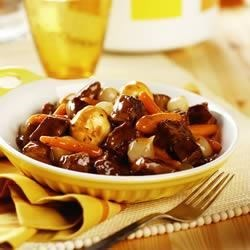 Slow Cooker Simple Beef Bourguignonne Recipe - Pieces of beef top round get fork-tender when they're slow cooked together with red wine, golden mushroom soup and vegetables to make this savory and delicious stew.