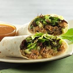 Asian Turkey Lettuce Wraps Recipe - Ground turkey, cucumber, and mint are flavored with Thai peanut sauce in these quick and easy wraps.