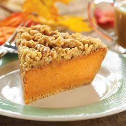 Maple Walnut Pumpkin Pie Recipe - This pumpkin pie has just a hint of maple and is served in a sweet graham cracker crust. A cinnamon walnut topping makes the perfect finish.