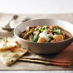 Slow Cooker Beef and Potato Curry Recipe - A slow-simmered curry with mild spicing is just the thing to warm you up on a wintry day. Serve with warmed Naan bread and a crisp cucumber salad.