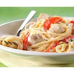 PHILLY Chicken Alfredo Pesto Pasta Recipe - Classic, fresh-tasting pesto sauce originated in Italy and is a favorite on pasta and chicken dishes. Here it adds delicious flavor to a simple Alfredo sauce made with cream cheese.