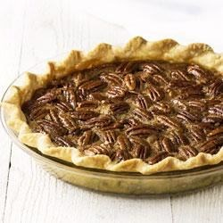Classic Pecan Pie Recipe - This classic pie combines eggs, corn syrup, vanilla, lots of pecans, and is baked to a burnished golden brown.