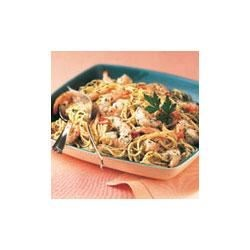 Garlic Shrimp and Pasta Recipe - Hot cooked spaghetti is tossed with tender shrimp in an exquisite sauce made with Swanson(R) Chicken Broth, garlic, lemon juice, parsley and red pepper flakes.