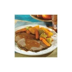 Swanson(R) Savory Pot Roast with Harvest Vegetables Recipe - This comforting dish of slow-simmered beef, potatoes and carrots gets its flavor from savory Swanson(R) Beef Stock.